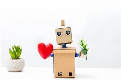 A robot holding a heart