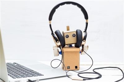 Robot listening to music on headphones