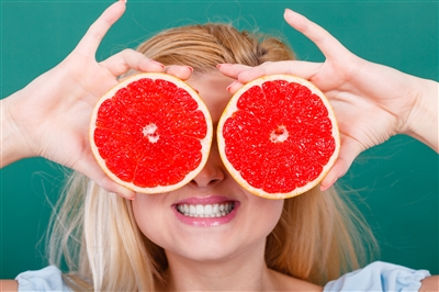 Woman with Ruby Grapefruit for eyes