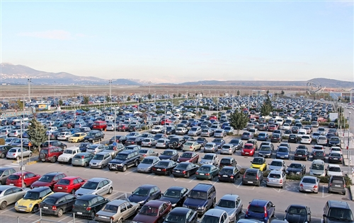 large number of cars unused in a parking lot