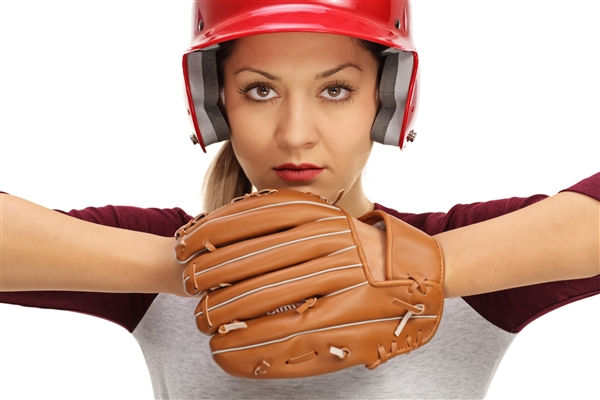 Woman baseball player looking determined